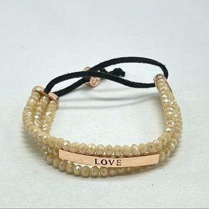 Jessica Simpson sparkling love bracelet in blush